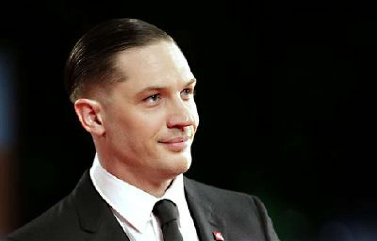 In this Sept. 2, 2013 file photo, actor Tom Hardy poses for photographers on the red carpet for the film Locke at the 70th edition of the Venice Film Festival held from Aug. 28 through Sept. 7, in Venice, Italy.