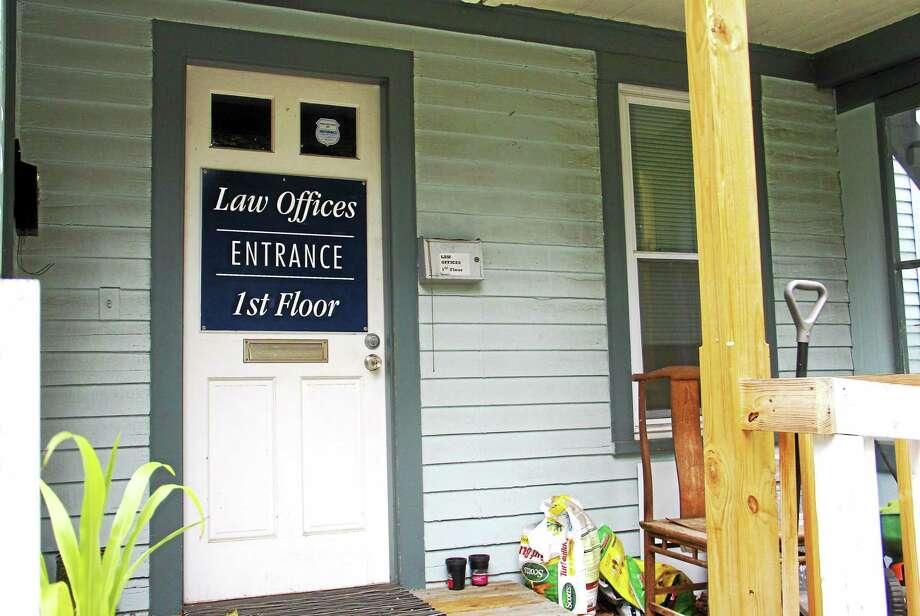 The door outside Ira Mayo's Torrington office on Cook Street Tuesday. Photo: Esteban L. Hernandez — The Register Citizen