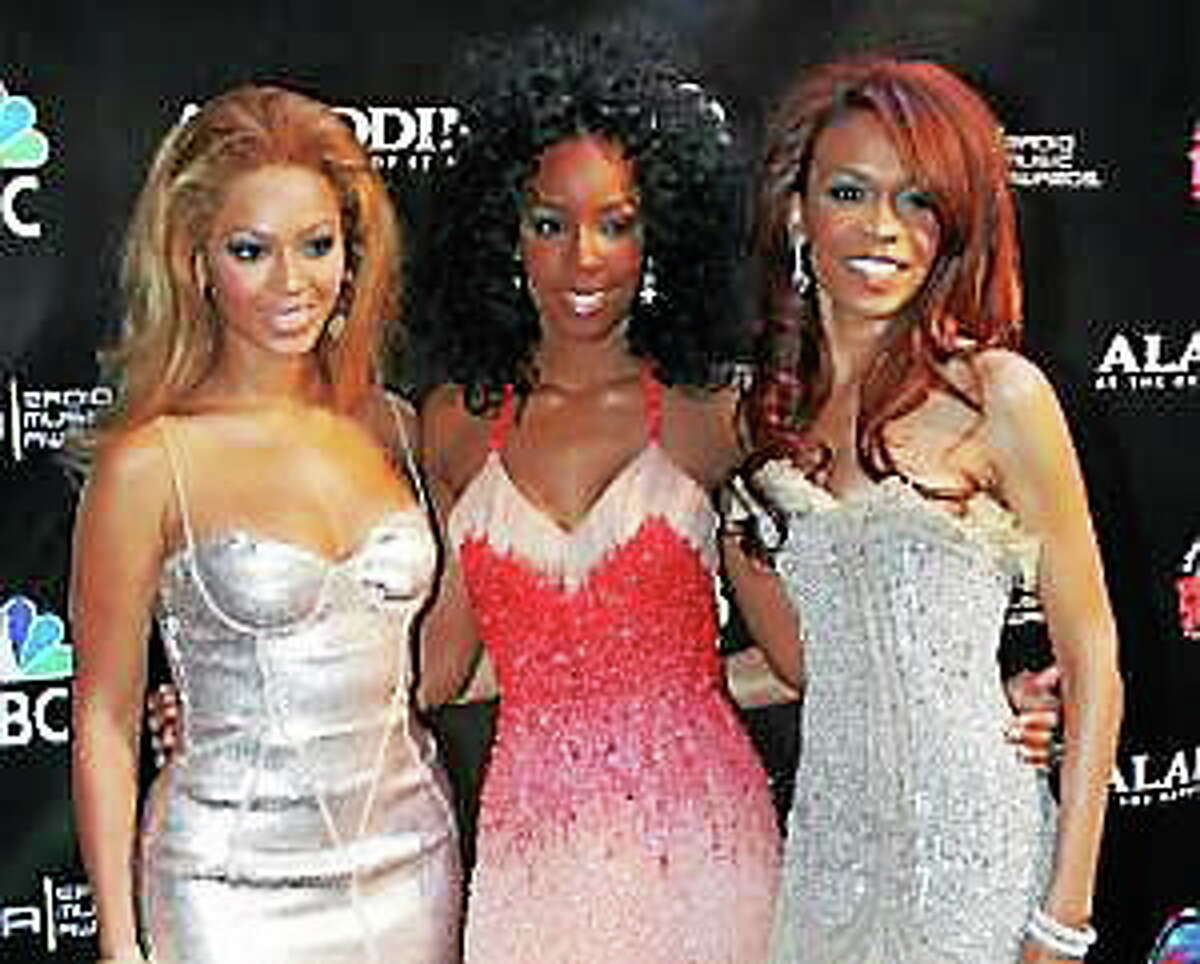 This Oct. 25, 2004, file photo shows members of Destiny's Child, from left, Beyonce Knowles, Kelly Rowland and Michelle Williams at the Radio Music Awards at the Aladdin Theater for the Performing Arts in Las Vegas.