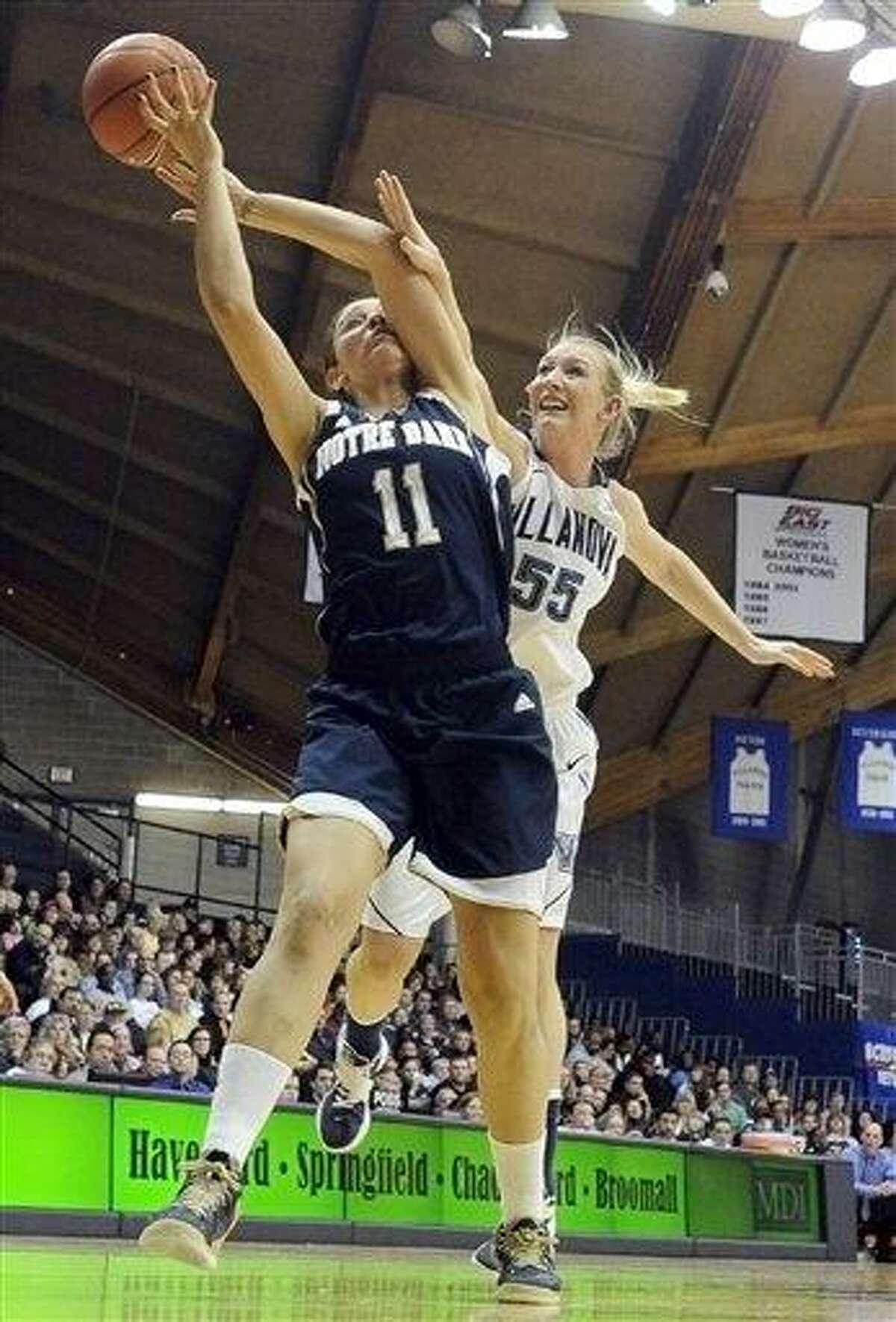 Villanova's Emily Leer (55) fouls Notre Dame's Natalie Achonwa (11) during the second half of an NCAA college basketball game, Tuesday, Feb. 5, 2013, in Villanova, Pa. Notre Dame won, 59-52. (AP Photo/Michael Perez)