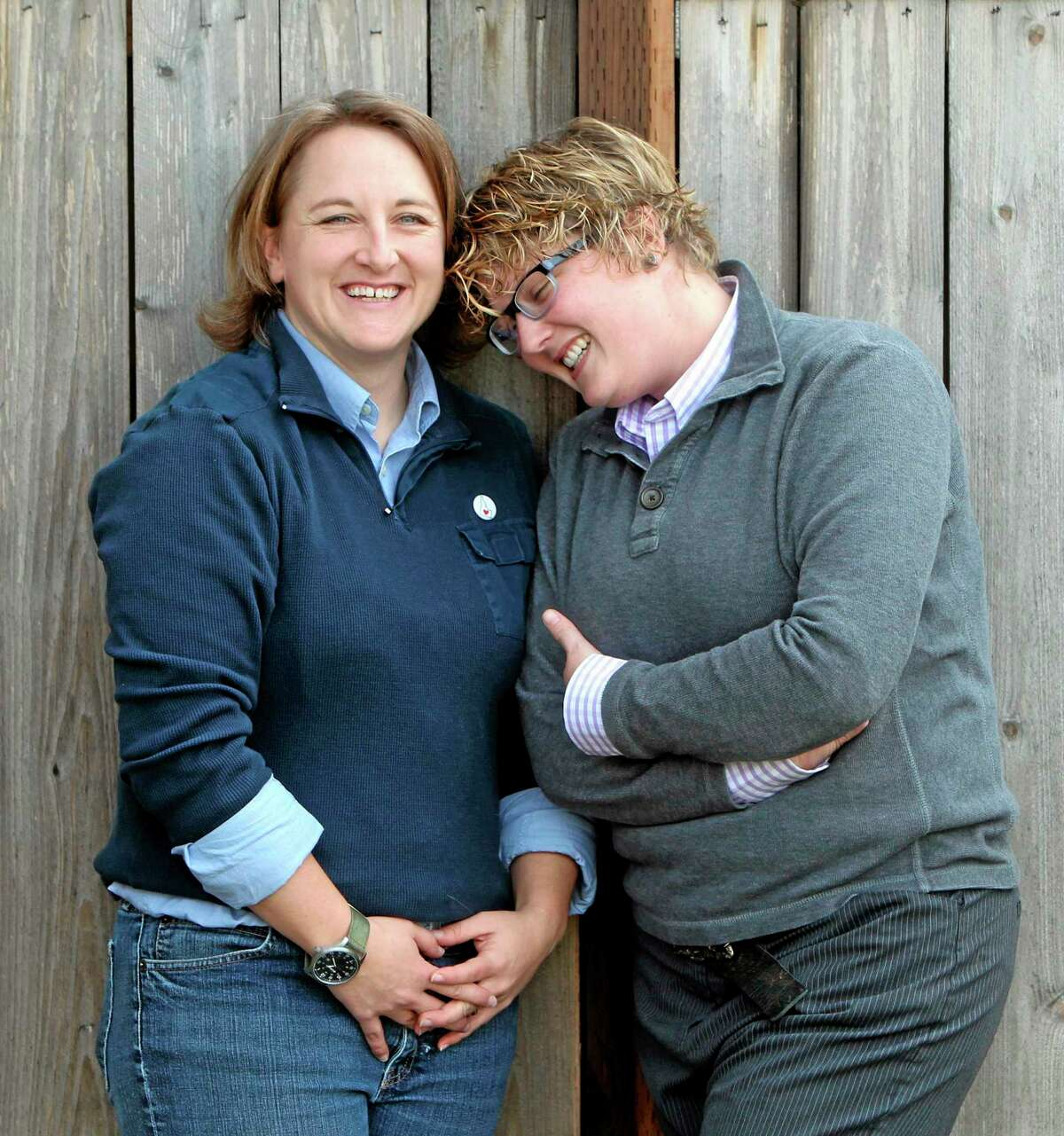FILE - In this Nov. 8, 2013 file photo, Amber Beierle, left, and Rachael Robertson pose for a photograph at their home in Boise, Idaho. They are one of four same-sex couples who are suing the state in federal court to challenge laws banning same-sex marriage and denying recognition to same-sex couples who married in other states. U.S. District Magistrate Judge Candy Dale ruled Tuesday evening, May 13, 2014, that Idaho's laws banning same-sex marriage unconstitutionally deny gay and lesbian citizens of their fundamental right to marry. Gov. C.L.