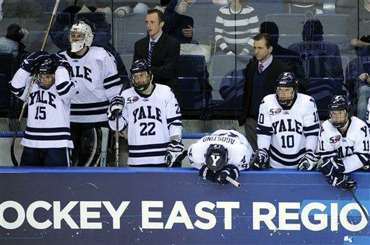 The Yale bench reacts late in the third period of their 5-3 loss to Minnesota-Duluth in an East regional final game in the NCAA college hockey tournament in Bridgeport, Conn., on Saturday, March 26, 2011. (AP Photo/Fred Beckham)