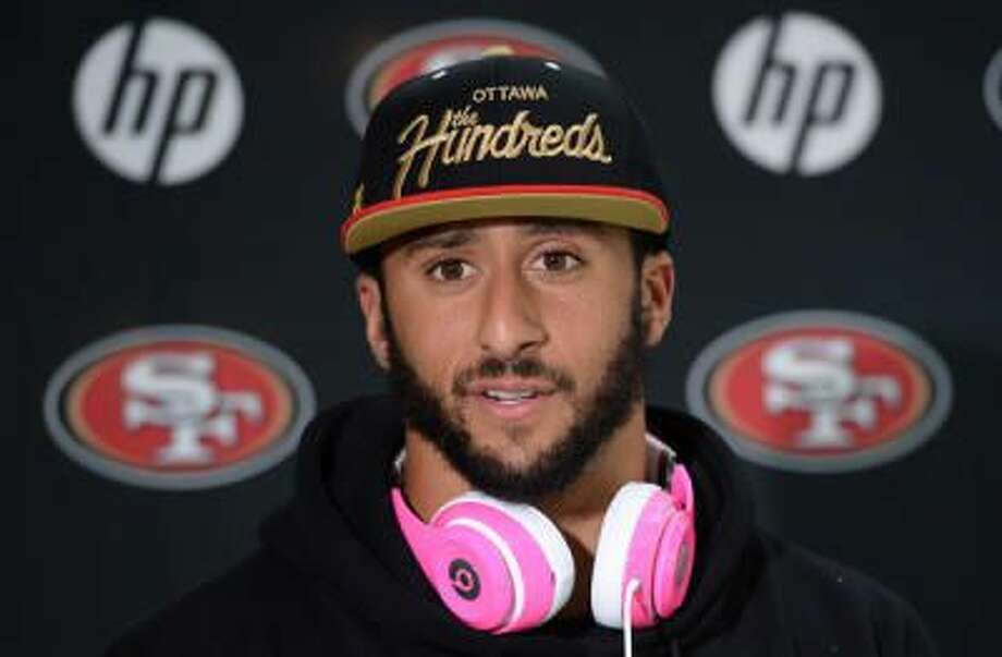San Francisco 49ers quarterback Colin Kaepernick listens during a press conference in Watford, north of London, Wednesday Oct. 23 2013, prior to their game against Jacksonville Cougars at Wembley Stadium in London on Sunday (AP Photo/Dave Shopland, NFL UK) Photo: AP / AP net