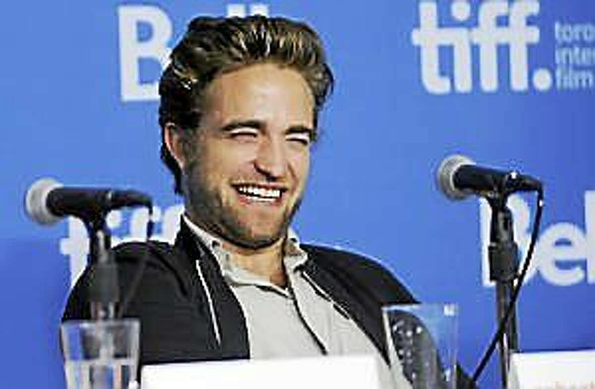 """Robert Pattinson attends the press conference for """"Maps to the Stars"""" on day 6 of the Toronto International Film Festival at the TIFF Bell Lightbox on Tuesday, Sept. 9, 2014, in Toronto."""