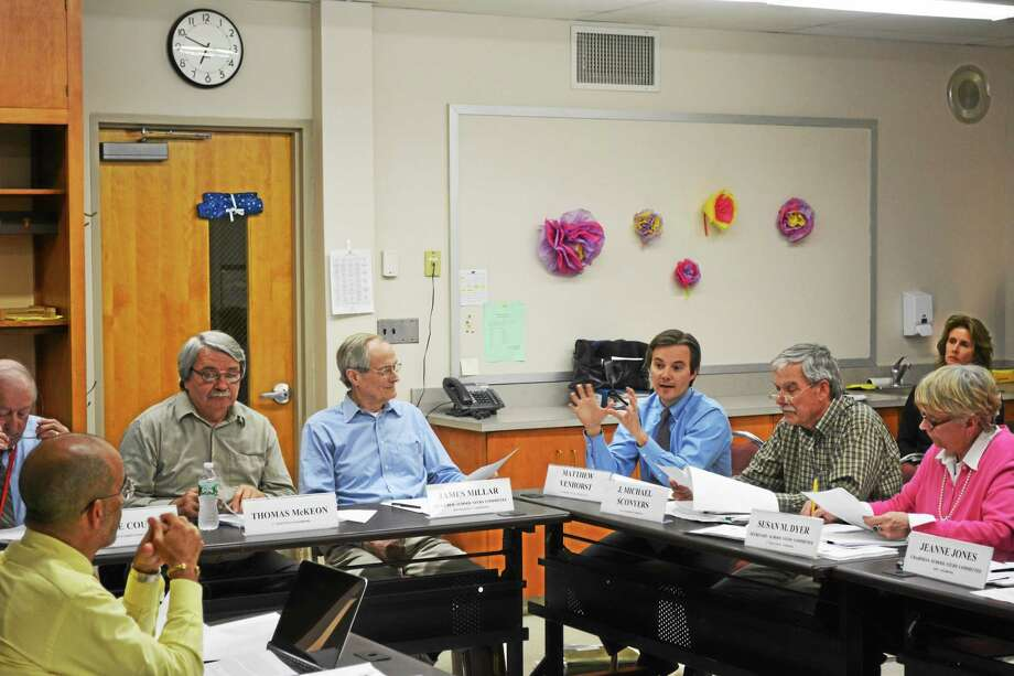 Matthew Venhorst and other members of the regional study committee discuss issues with the current draft plan of a Norfolk-Colebrook school merger Tuesday. Photo: Ryan Flynn — Register Citizen