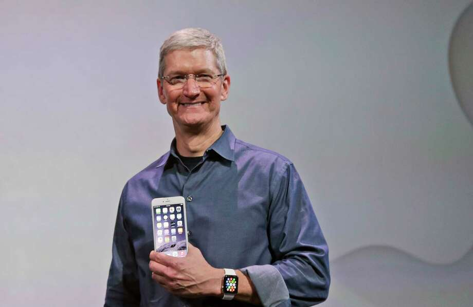 Apple CEO Tim Cook discusses the new Apple Watch and iPhone 6 on Tuesday, Sept. 9, 2014, in Cupertino, Calif. Photo: (AP Photo/Marcio Jose Sanchez) / AP