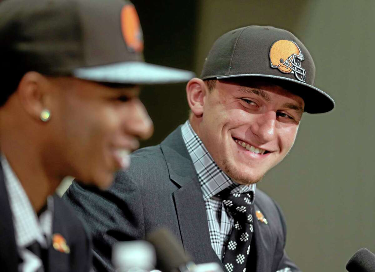 Cleveland Browns quarterback Johnny Manziel, right, from Texas A&M, watches cornerback Justin Gilbert during their introductory news conference last Friday.