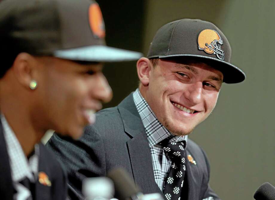 Cleveland Browns quarterback Johnny Manziel, right, from Texas A&M, watches cornerback Justin Gilbert during their introductory news conference last  Friday. Photo: Tony Dejak — The Associated Press  / AP