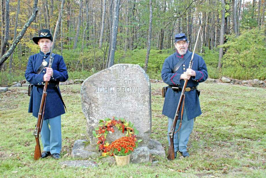 Christopher Purrone, left, and Dane Deleppo, right stand at John Brown's birthplace in this file photo. It was the 150th anniversary of his raid on Harpers Ferry. Photo: Torrington Historical Society Collection