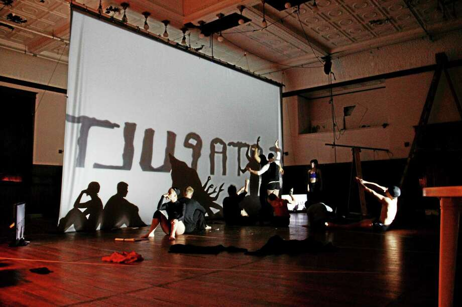 "Members of Catapult Entertainment prepare for a run-through rehearsal of their ""shadow art"" in Torrington on Aug. 16, 2013. Photo: Register Citizen File Photo"