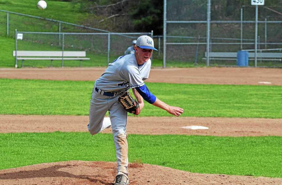 Lewis Mills' Justin Gallicchio threw a complete game, allowing just two hits and struck out 10 batters in the Spartansí 5-1 win over Thomaston. Photo: Pete Paguaga — Register Citizen