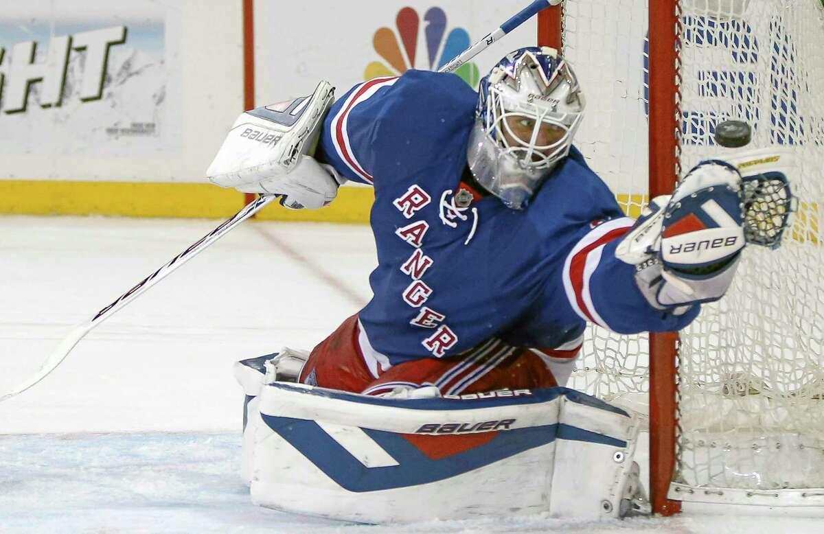 Rangers goalie Henrik Lundqvist makes a save during Game 6 against the Penguins.