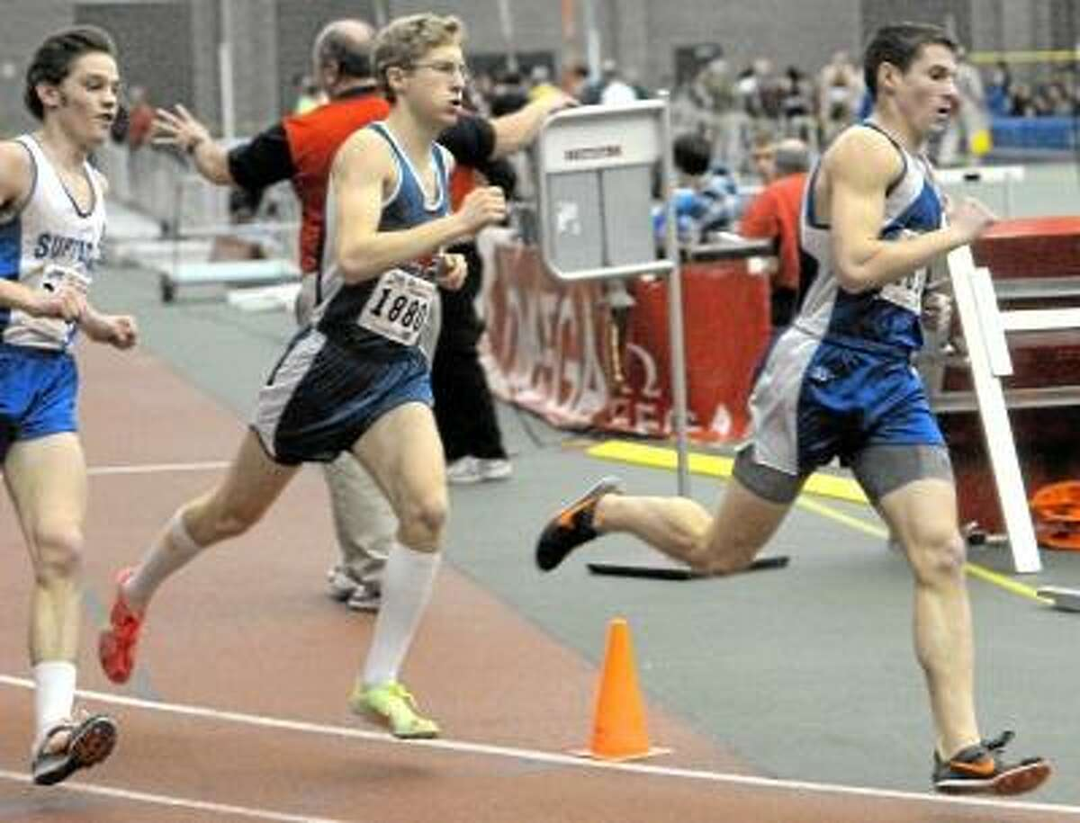 Lewis Mills' Patrick Claffey, right, runs in the 1,000 meter race at the Class M indoor track championship at the Floyd Little Athletic Center in New Haven. Photo by Peter Hvizdak/New Haven Register