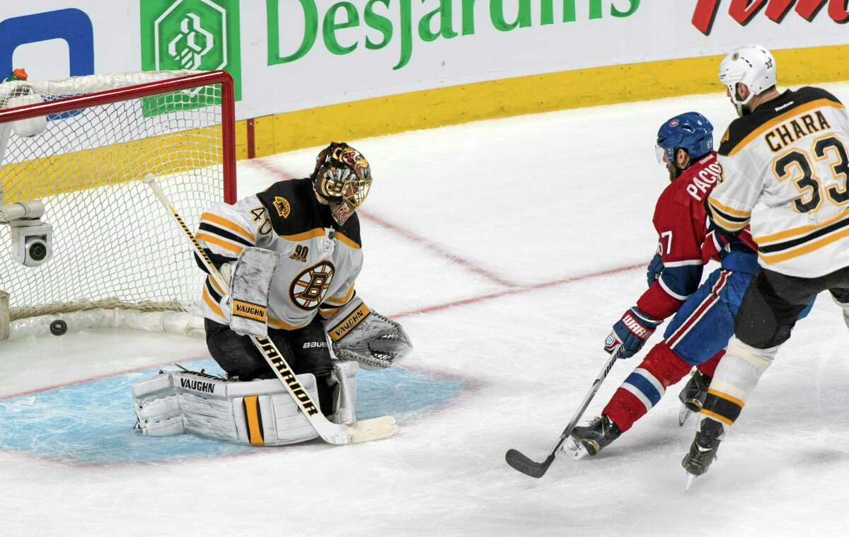 Montreal Canadiens' Max Pacioretty, center, scores on Bruins goalie Tuukka Rask as Bruins defenseman Zdeno Chara (33) looks on during the second period Monday.