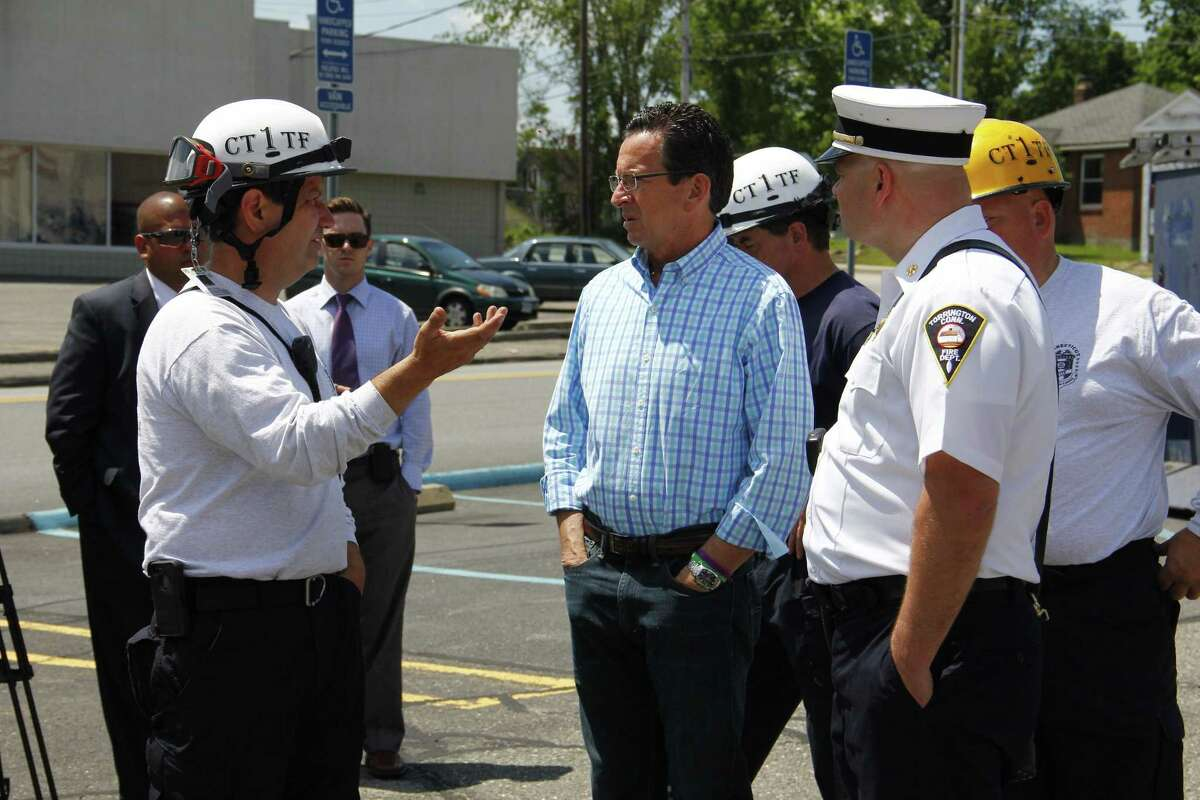 Gov. Dannel P. Malloy talks to CT Task Force One Commander John Ricci, of Middletown, and other first responders at a building collapse drill in Torrington. Esteban L. Hernandez -- Register Citizen.