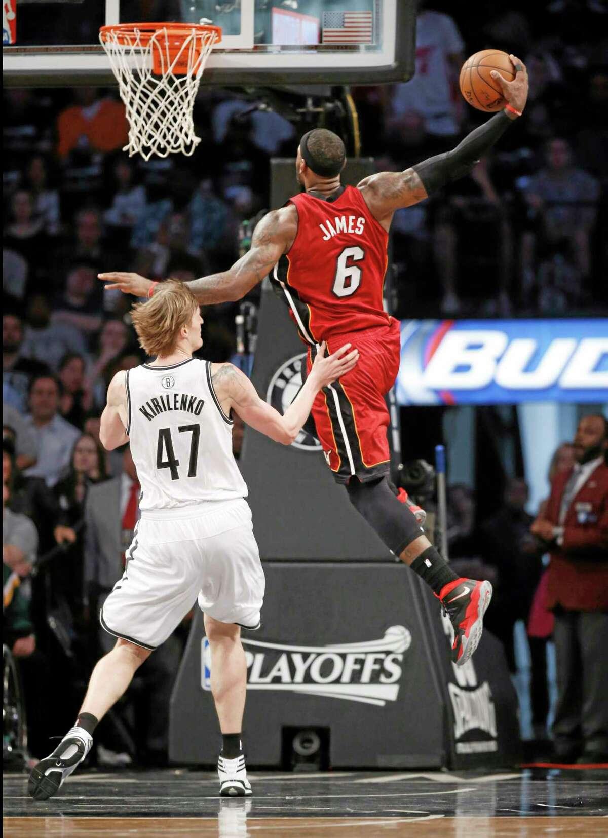 Miami Heat forward LeBron James (6) scores over Brooklyn Nets forward Andrei Kirilenko (47) in the first half of Game 4 Monday.