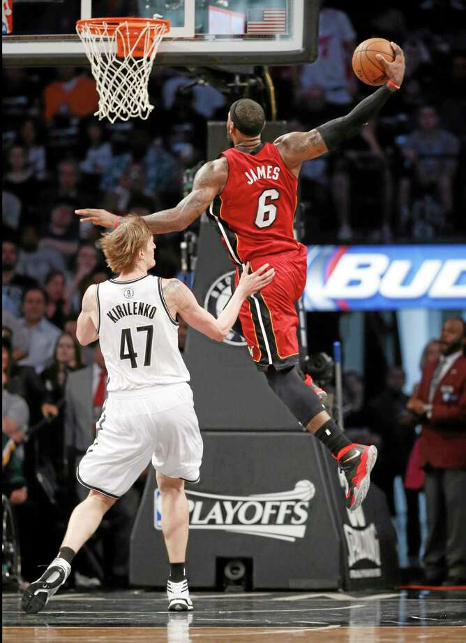 Miami Heat forward LeBron James (6) scores over Brooklyn Nets forward Andrei Kirilenko (47) in the first half of Game 4 Monday. Photo: The Associated Press  / AP