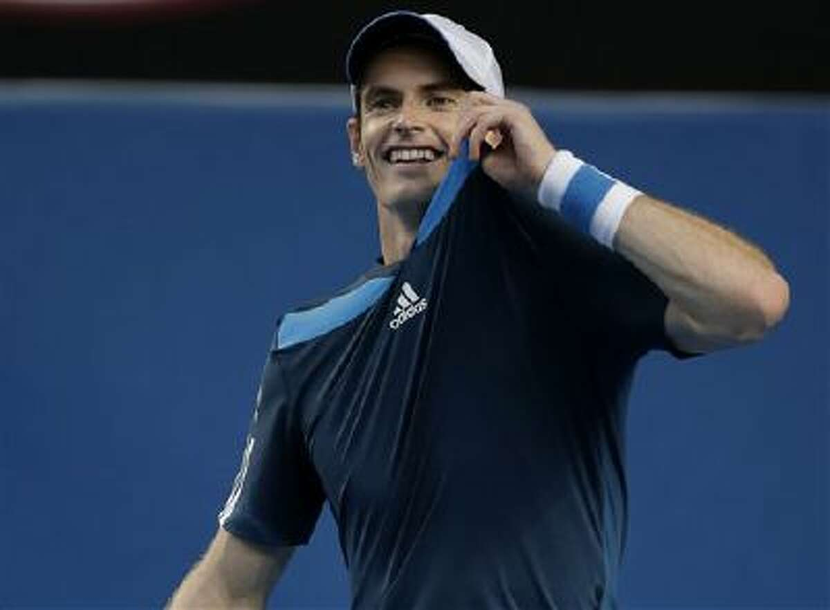 Andy Murray of Britain holds up his shirt during his fourth round match against Stephane Robert of France at the Australian Open tennis championship in Melbourne, Australia, Monday, Jan. 20, 2014.