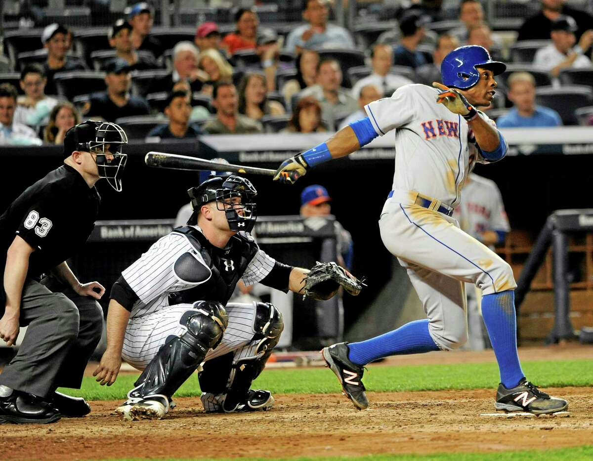 The Mets' Curtis Granderson hits a two-run home run in the sixth inning Monday at Yankee Stadium.
