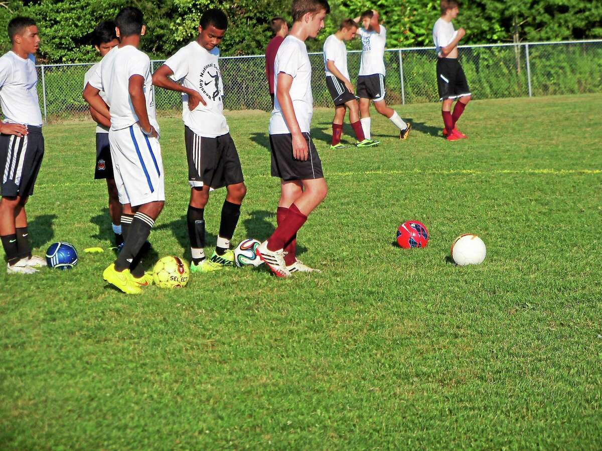 Torrington boys soccer players participate during a practice this offseason.