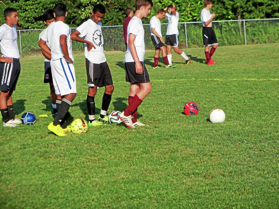 Torrington boys soccer players participate during a practice this offseason. Photo: Peter Wallace - Register Citizen