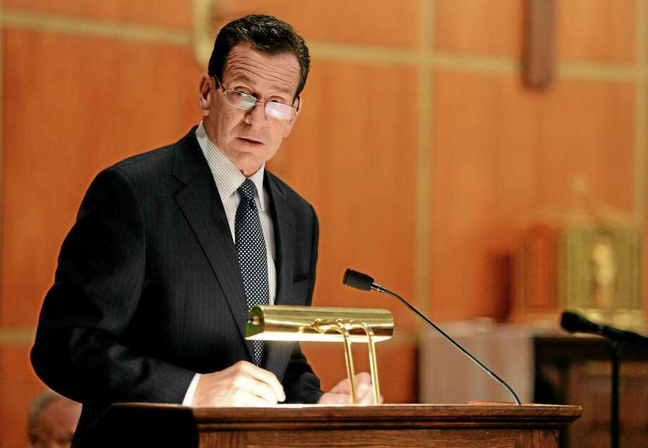 Connecticut Gov. Dannel Malloy speaks to mourners at a vigil service for victims of the Sandy Hook Elementary School shooting, at the St. Rose of Lima Roman Catholic Church in Newtown, Conn. Friday, Dec. 14, 2012. A man killed his mother at their home and then opened fire Friday inside the elementary school where she taught, massacring 26 people, including 20 children, as youngsters cowered in fear to the sound of gunshots reverberating through the building and screams echoing over the intercom (AP Photo/Andrew Gombert, Pool) Photo: AP / Pool EPA