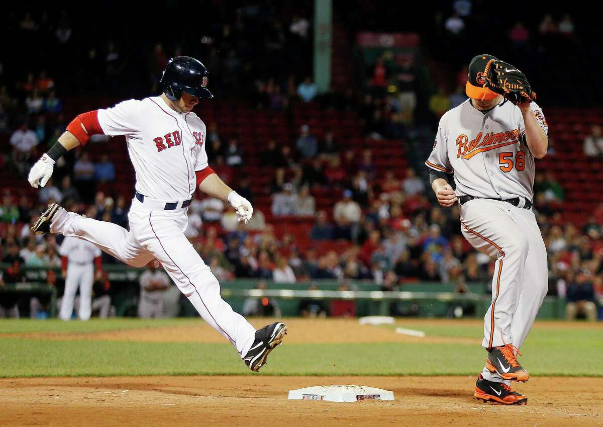 Baltimore Orioles' Ryan Webb (58) beats Boston Red Sox's Daniel Nava to first base on a ground out during the ninth inning of a baseball game in Boston, Monday, Sept. 8, 2014.