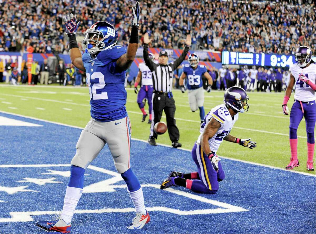 Giants wide receiver Rueben Randle (82) celebrates after catching a touchdown pass on Monday.