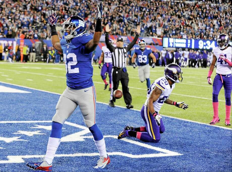 Giants wide receiver Rueben Randle (82) celebrates after catching a touchdown pass on Monday. Photo: Bill Kostroun — The Associated Press  / FR51951 AP