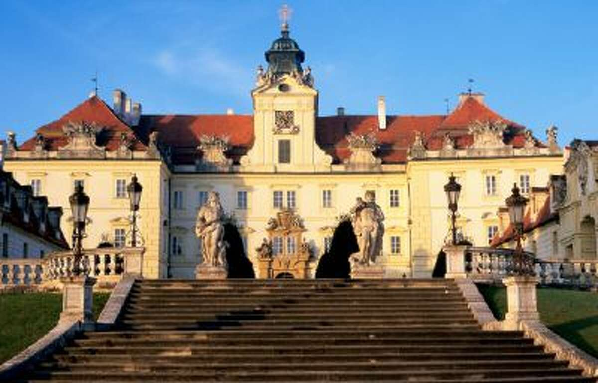 Baroque chateau, by JB Fischer van Eriach and D Martinelli, at sunrise.