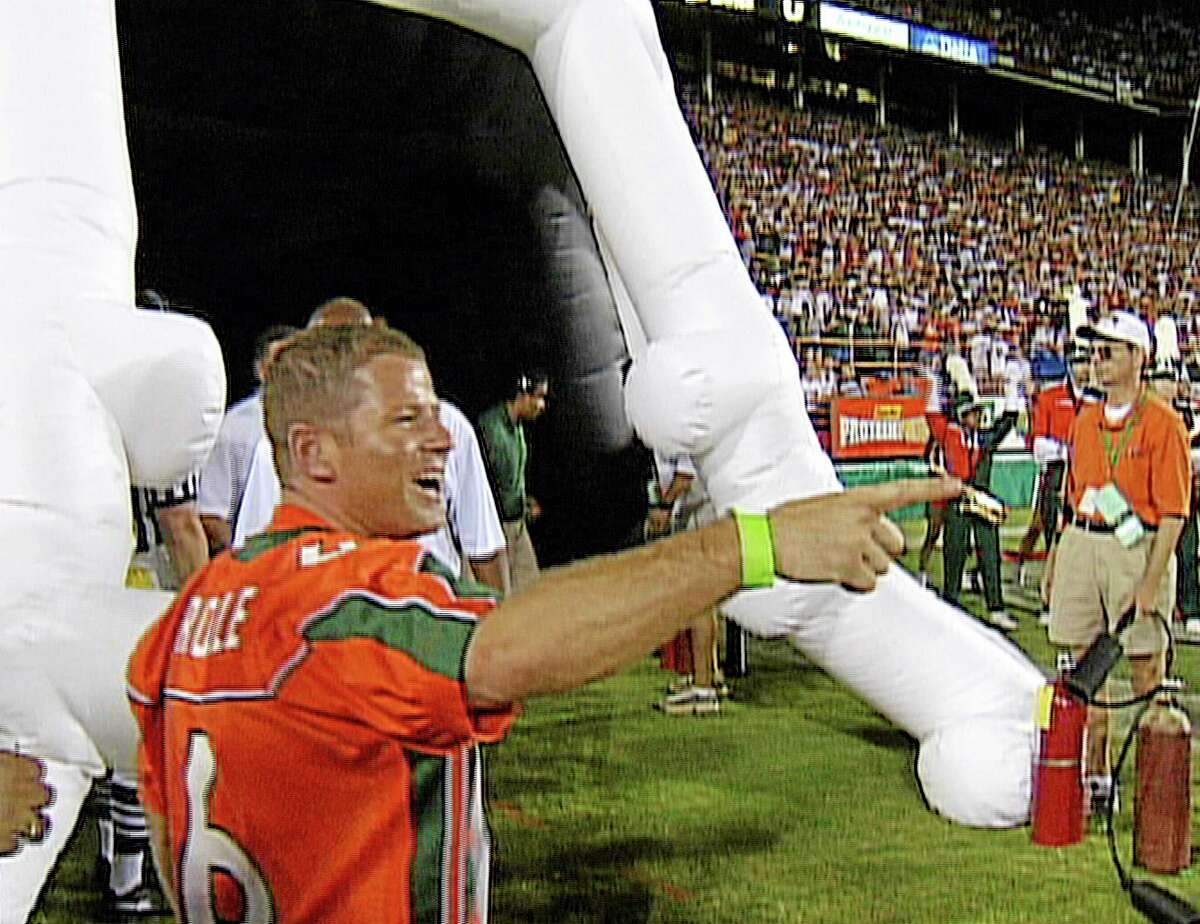 This image from a Sept. 2003, video shows Miami booster Nevin Shapiro on the field at a game between Miami and Florida in Miami, Fla. Miami will lose nine football scholarships over three years as part of the penalties in the booster scandal.