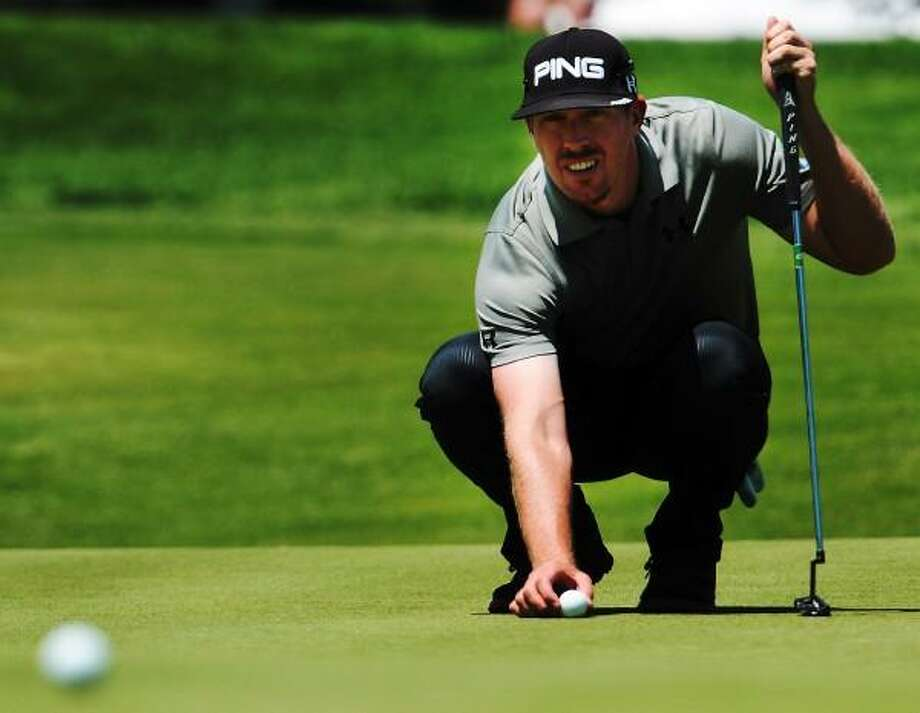 Hunter Mahan lines up his putt at the 9th Hole  during first round of golf Thursday June 20, 2013  of the PGA  2013 Travelers Championship  at the Tournament Players Club River Highlands in Cromwell, Conn. Peter Hvizdak - New Haven Register Photo: New Haven Register / ©Peter Hvizdak /  New Haven Register