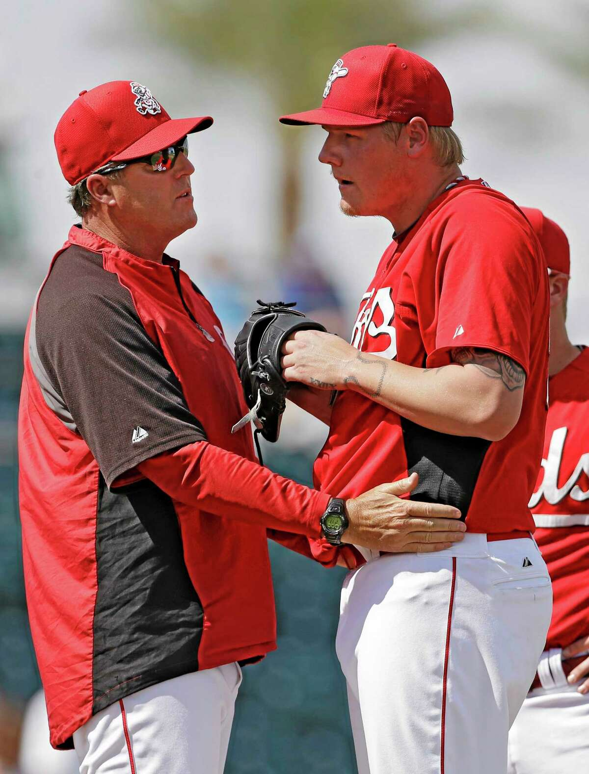 In this March 28 file photo, Cincinnati Reds pitching coach Bryan Price, left, talks to starter Mat Latos in the third inning of a spring training game against the Kansas City Royals in Goodyear, Ariz. The Reds have chosen Price to replace Dusty Baker as their next manager.
