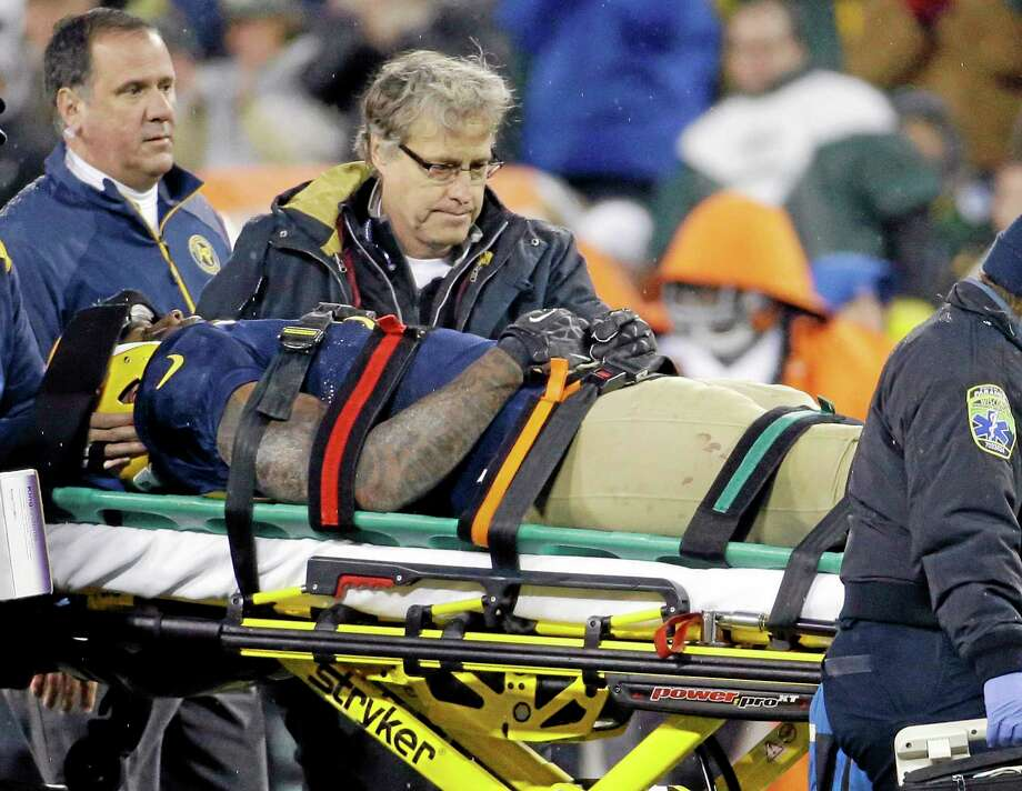 The Packers' Jermichael Finley is taken off the field on a stretcher during the second half of Sunday's game against the Cleveland Browns in Green Bay, Wis. Photo: Morry Gash - The Associated Press  / AP