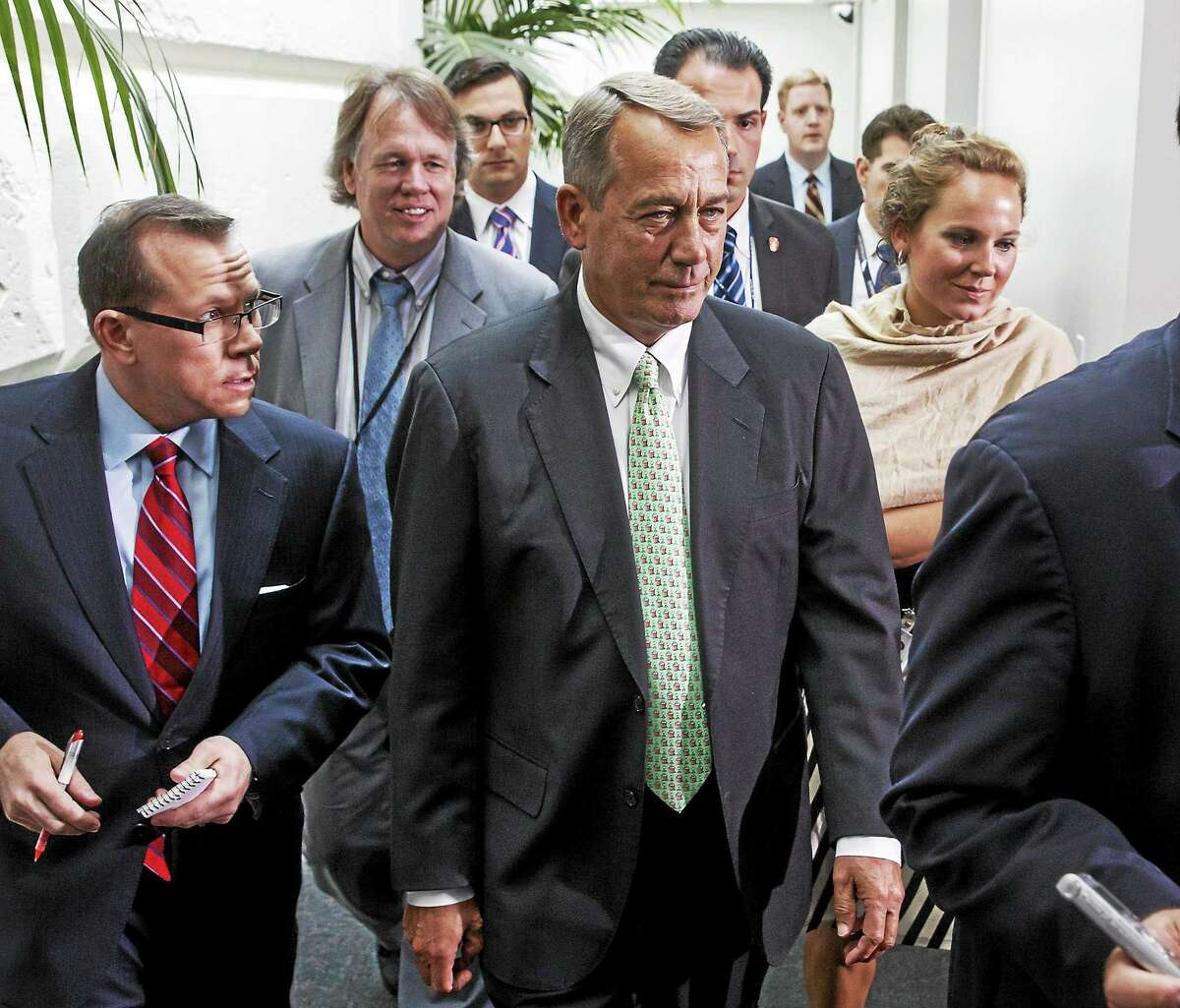 Speaker of the House John Boehner of Ohio, walks past reporters following a closed-door meeting of House Republicans on Capitol Hill in Washington, Friday, Aug. 1, 2014, to discuss the border crisis. Immigration is just one of several issues pending before Congress as it returns from its August recess.