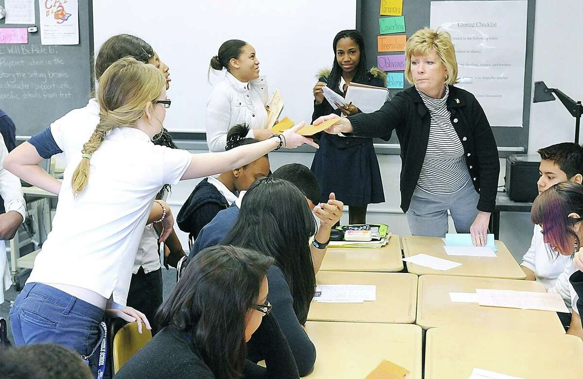 School nurse Cheryl Brumbaugh hands out letters to 8th grade students at Stewart Middle School in Norristown Feb. 23, 2012.