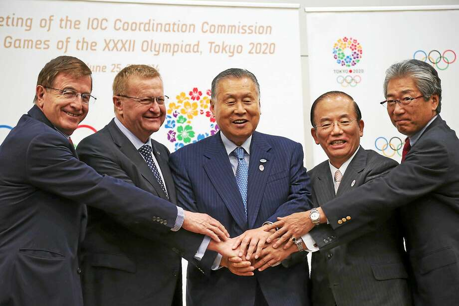 From left, IOC Executive Director for the Olympic Games Gilbert Felli, IOC Vice President John Coates, Tokyo Organizing Committee of the Olympic and Paralympic Games President Yoshiro Mori, Chief Executive Officer Toshiro Muto, and Tsunekazu Takeda, a member of the International Olympic Committee and president of Japanese Olympic Committee, pose during a press conference after the first coordination commission meeting for the Tokyo 2020 Games, in Tokyo on June 27, 2014. Photo: AP Photo/Koji Sasahara  / AP