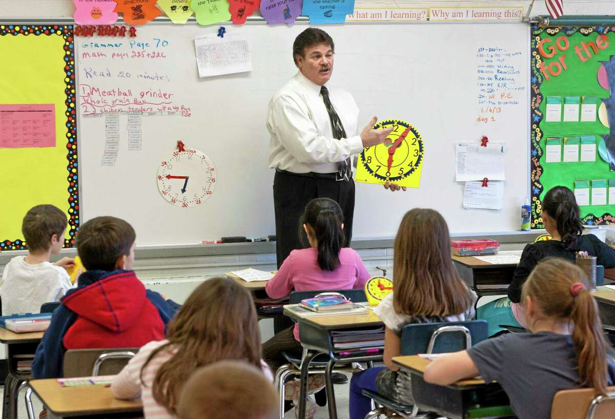 Louis Faiella teaches his third grade class a lesson on adding and subtracting time at Rock Hill School in Wallingford, Conn. on Feb. 6, 2013.