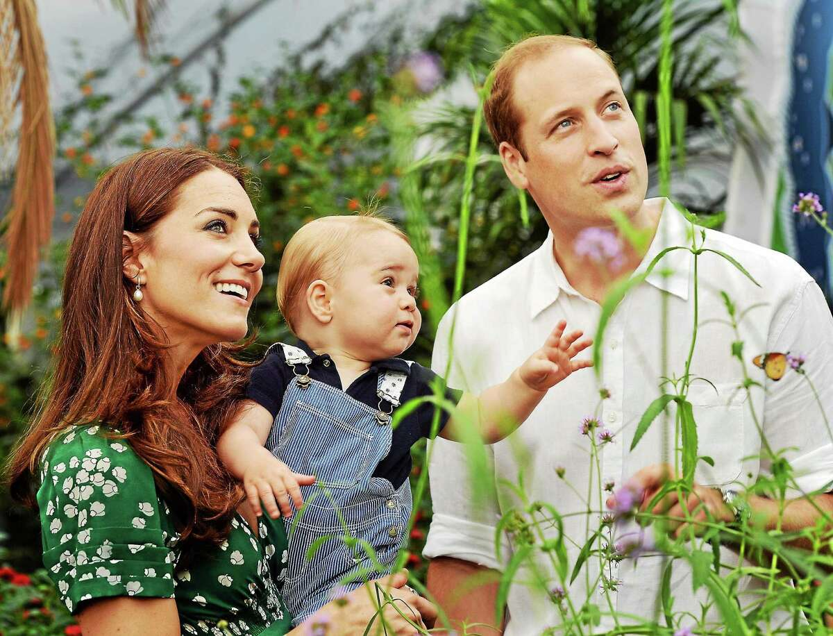 This photo taken July 2, 2014 to mark Prince George's first birthday, shows Britain's Prince William and Kate Duchess of Cambridge and the Prince during a visit to the Sensational Butterflies exhibition at the Natural History Museum, London.