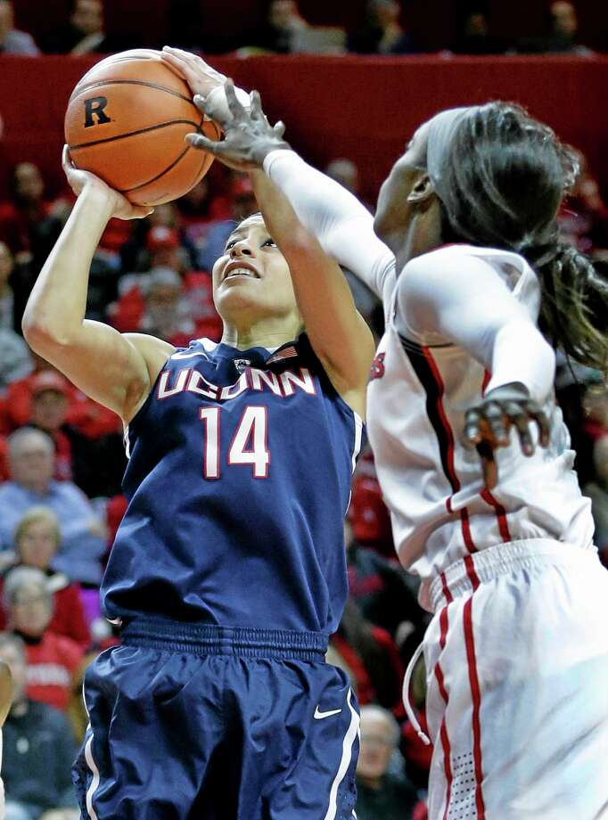 UConn's Bria Hartley, left, takes a shot as Rutgers forward Kahleah Copper tries to block her path during the first half Sunday. Photo: Mel Evans — The Associated Press  / AP