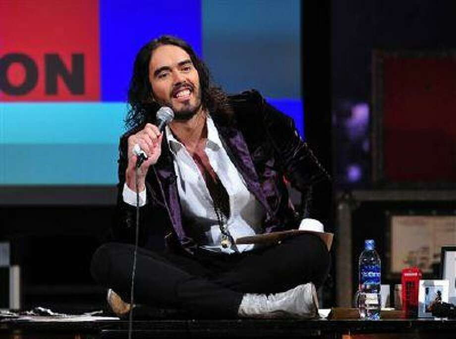"""This March 14, 2013 photo released by FX shows Russell Brand, host of the FX series """"Brand X with Russell Brand."""" The British comedian announced Thursday, June 6, that he's launching a world comedy tour focusing on Che Guevara, Gandhi, Malcolm X and Jesus Christ. Brand says the show examines """"the importance of heroes in this age of atheistic disposability."""" The """"Messiah Complex"""" tour is set to begin August 15 in Abu Dhabi and wrap up Dec. 9 in Iceland. (AP Photo/FX/Ellis O'Brien) Photo: AP / FX"""
