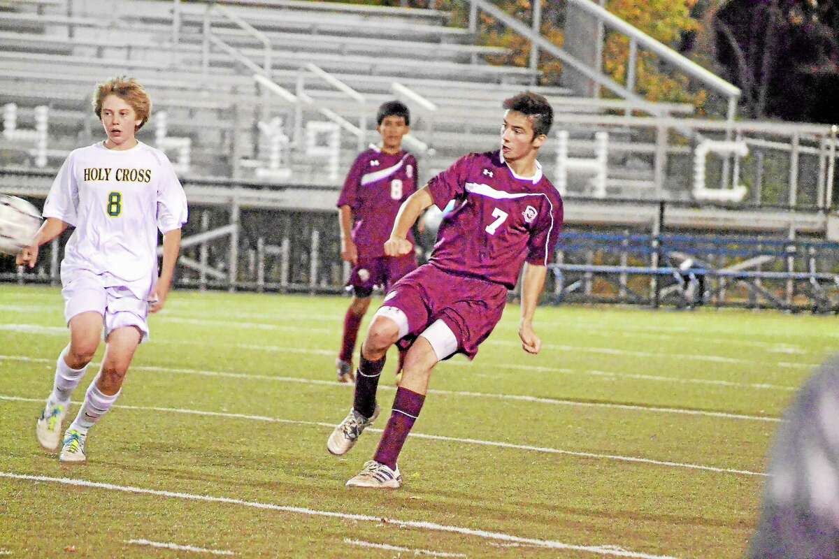 Torrington's Shane Bierfeldt makes a pass during the Red Raiders 3-0 win over Holy Cross.