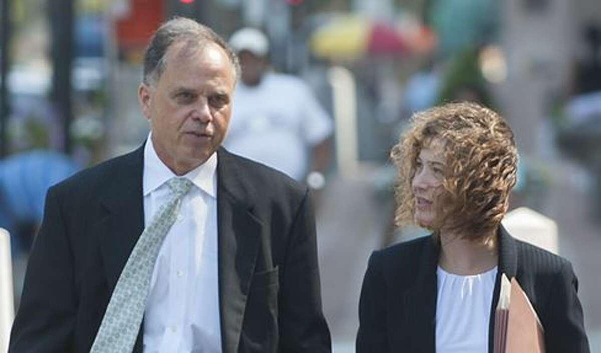 Brian Foley, left, and his attorney, Jessica Santos outside federal court.