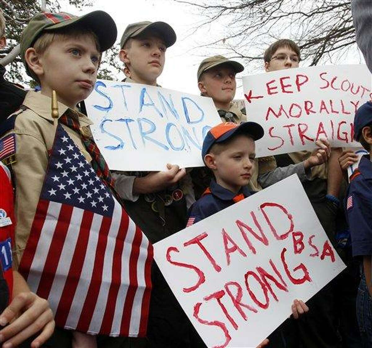 Clockwise from left, Boy Scouts Eric Kusterer, Jacob Sorah, James Sorah, Micah Brownlee and Cub Scout John Sorah hold signs at the