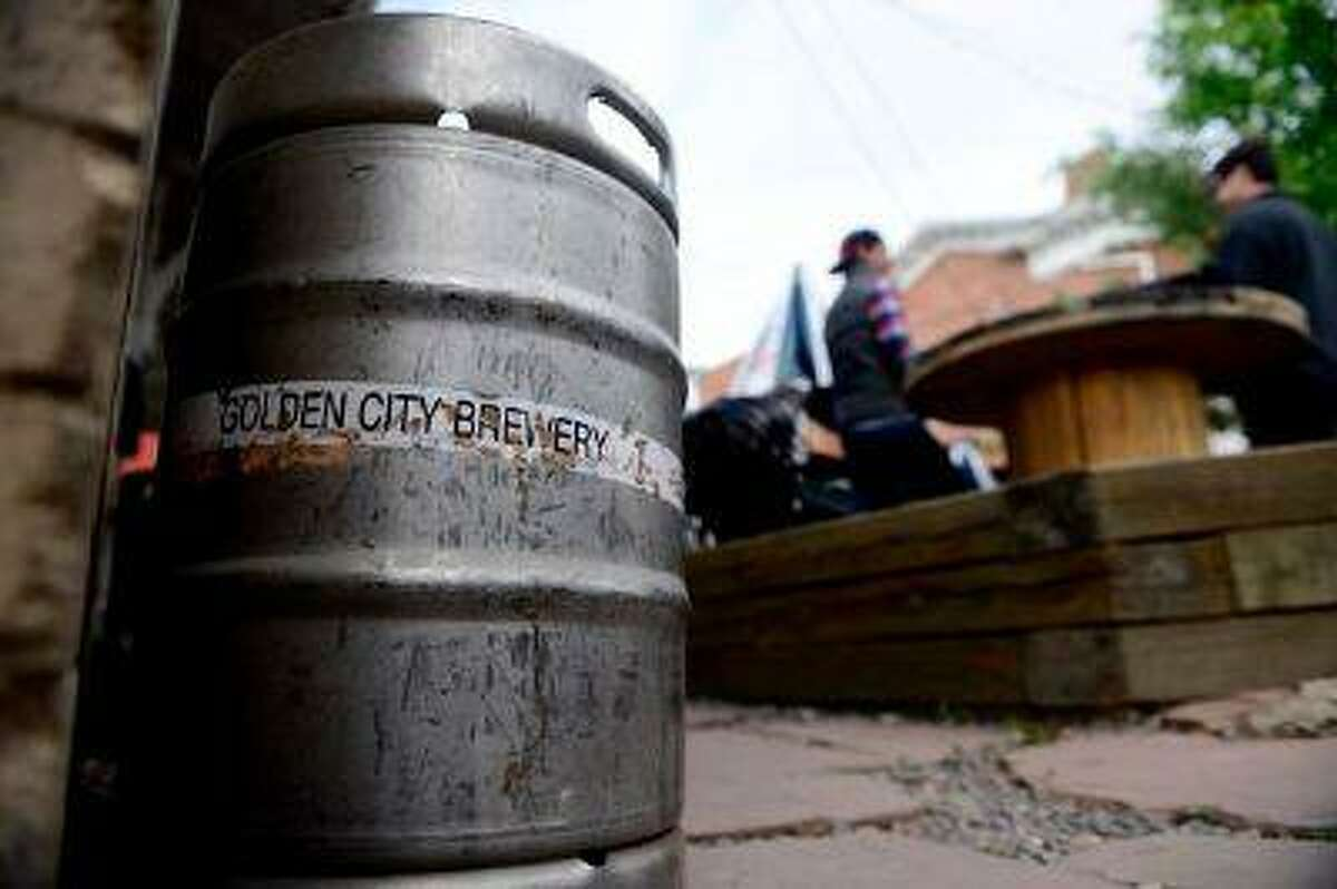 GOLDEN, CO - JUNE 5: Patrons drink on the patio at Golden City Brewery. Golden City Brewery is among the 10 best breweries with patios in Colorado. (Photo by AAron Ontiveroz/The Denver Post)