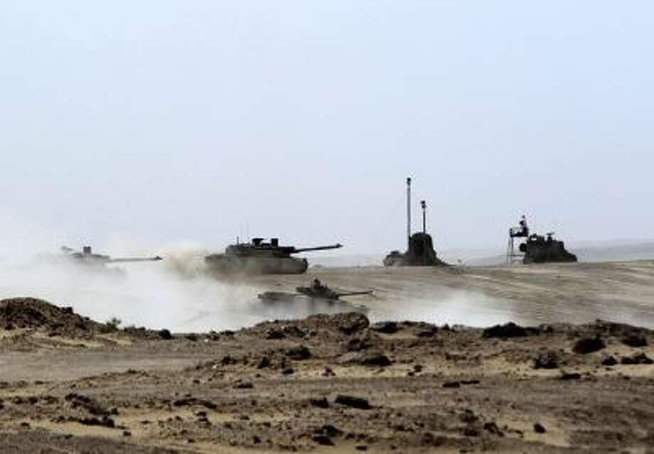 UAE tanks drive during joint military maneuvers with the French army in the desert of Abu Dhabi May 2, 2012.