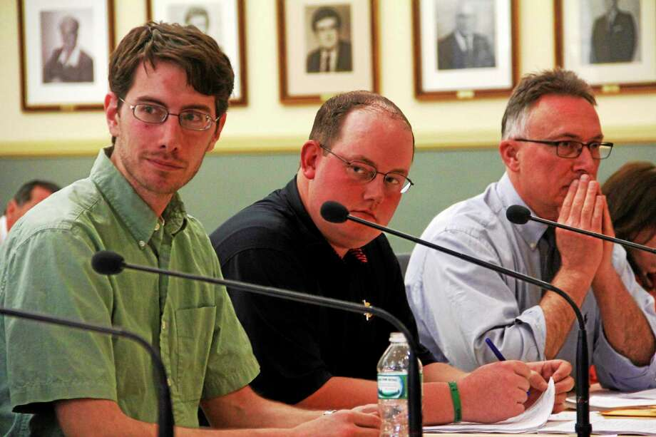 From left: Council members Christopher Anderson, Gregg Cogswell and Paul Cavagnero during a special joint City Council and Board of Finance meeting on Monday, May 12, 2014, in Torrington. The council voted 3-2 to approve the city's $52.4 million budget, which moves forward to the Board of Finance. Photo: Esteban L. Hernandez — Register Citizen