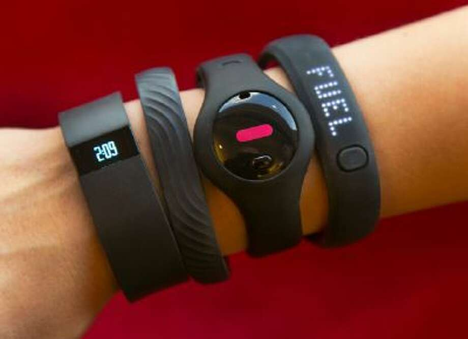 Fitness trackers. From left, Fitbit Force, Jawbone Up, Fitbug Orb, and the Nike FuelBand SE.