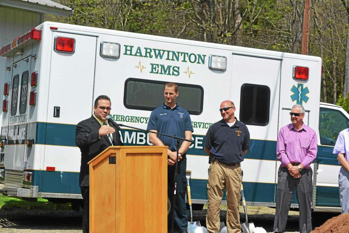 Harwinton First Selectman Michael Criss thanks the people and organizations that brought the town's new EMS headquarters to the groundbreaking point during a ceremony Monday.
