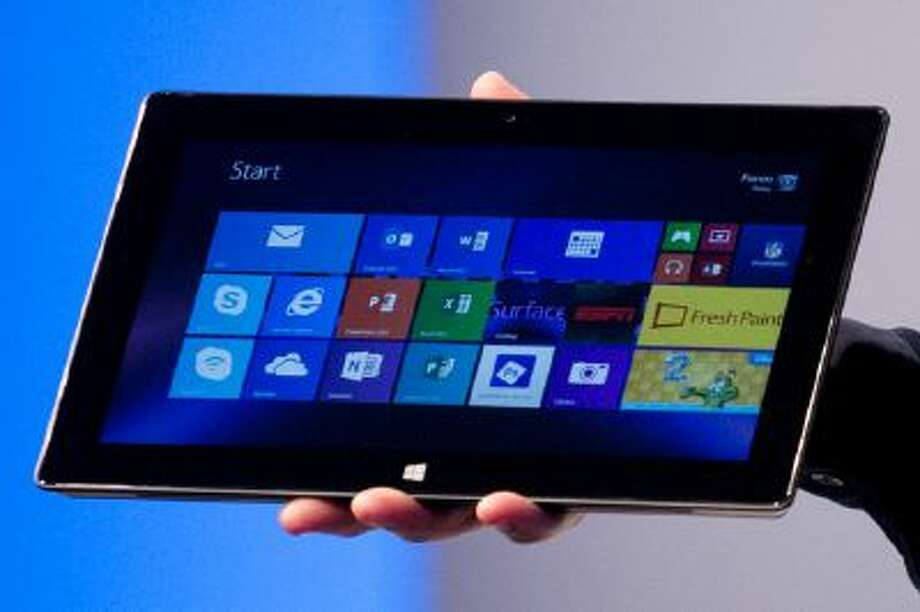 In this Sept. 23, 2013 photo, Microsoft's Surface Pro 2 is introduced, in New York. The tablets can be great for working on the go, especially if you spring for a $130 keyboard cover. On the flip side, the new versions still lack the elegance and fun that iPads are known for and many Android-based tablets now offer.